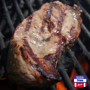 Prime strip steak on the grill